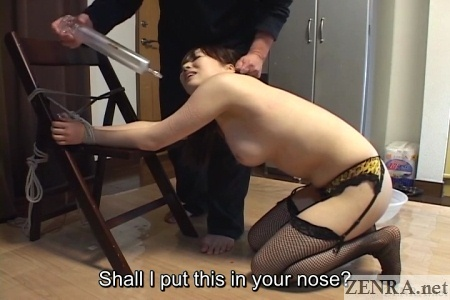 Bent over Japanese woman with enema
