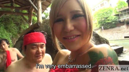 Embarrassed Japanese newhalf at outdoor onsen