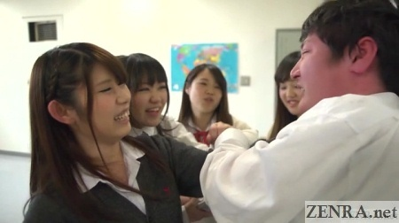 Red faced classmate teased by schoolgirls
