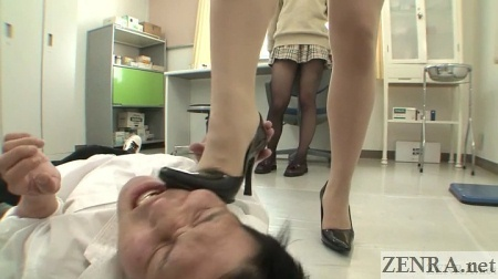 Japanese teacher rubs high heels into male student