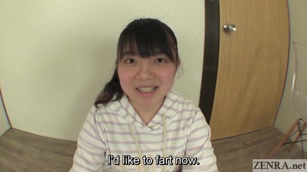 Japanese schoolgirl prepares to fart