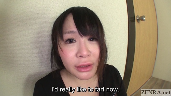Japanese woman with red cheeks wants to fart bad