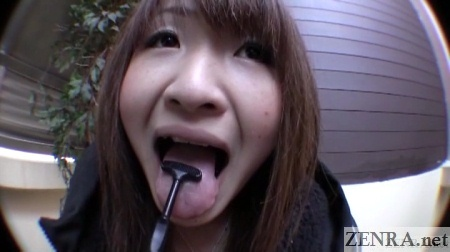 Japanese woman cleans tongue