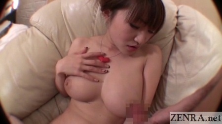 Huge Japanese breasts with dick rubbed on them