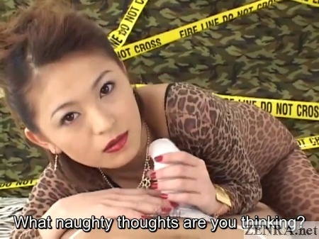 Japanese woman in leopard leotard gives handjob