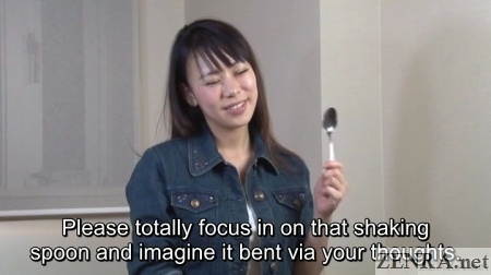 Japanese woman holds spoons