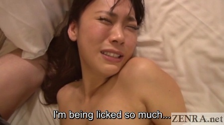 Flushed Japanese woman receives oral sex