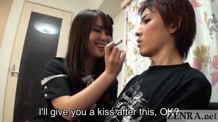 Japanese girlfriend puts makeup on boyfriend