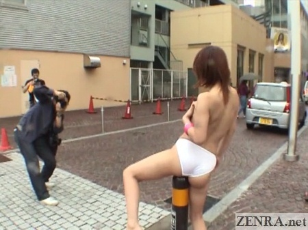 Topless Japanese woman masturbates in public