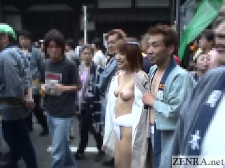 Topless Japanese woman in loincloth at festival