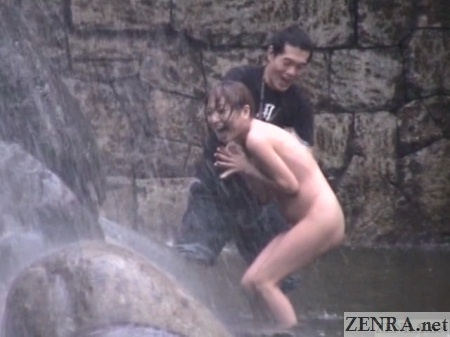 Surprised Japanese public nudist under waterfall
