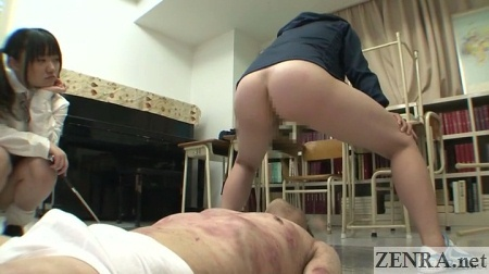 Bottomless Japanese teacher squats over student