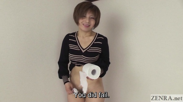 Bottomless Japanese woman holds toilet paper