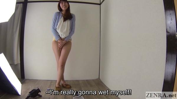 Japanese woman in panties holds in pee