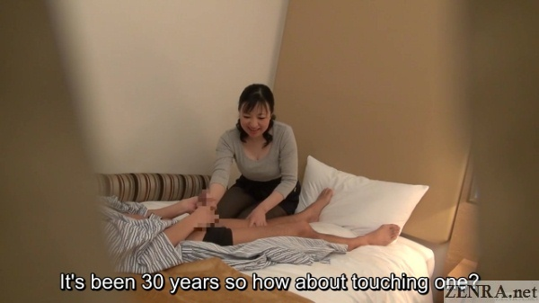 shy handjob by clothed older japanese masseuse
