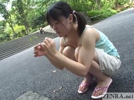japanese schoolgirl playing in park wearing camisole