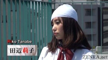 schoolgirl with head bandage on rooftop