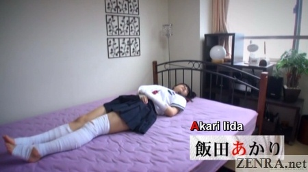 bandaged up schoolgirl in bed with ennui