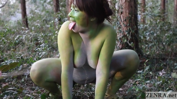 squatting naked japanese frog woman outside in forest