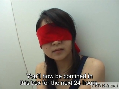 blindfolded japanese woman in box