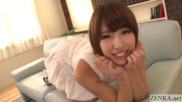 matsuoka seira resting on leather sofa
