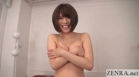 embarrassed tokiwa seiko covers chest