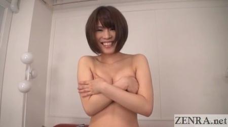 embarrassed tokiwa seiko covers chest