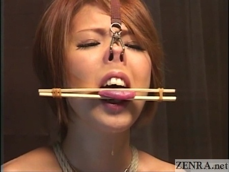chopsticks affixed to tongue japanese bondage