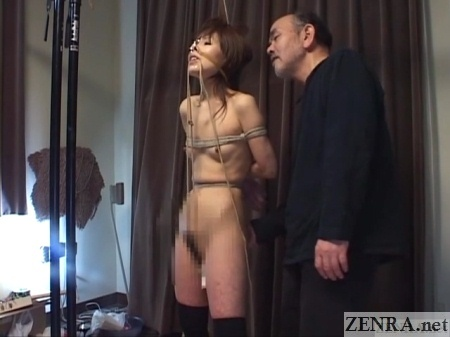 bound japanese woman with nose hooks and clamps