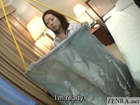 japanese woman changes into schoolgirl uniform