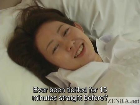 smiling japanese schoolgirl after tickling