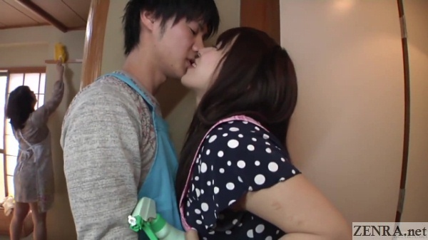young japanese couple steals a kiss