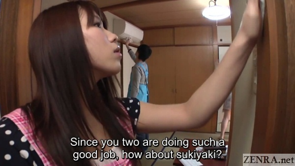 young japanese couple cleans room
