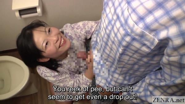 smiling japanese milf holds erection