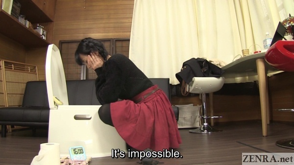 japanese woman stares deeply into toilet