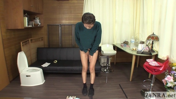bottomless japanese amateur stands in puddle of pee
