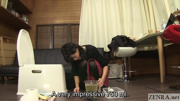 amateur japanese woman measures urine output