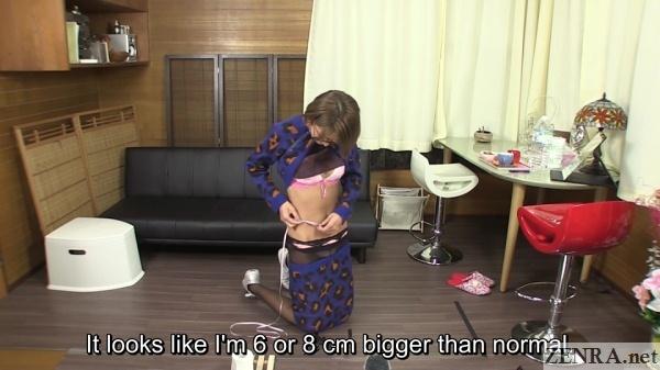slim japanese woman measures waist