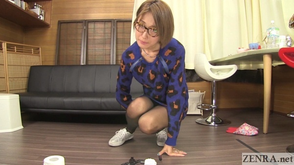 squirming japanese amateur holds in pee
