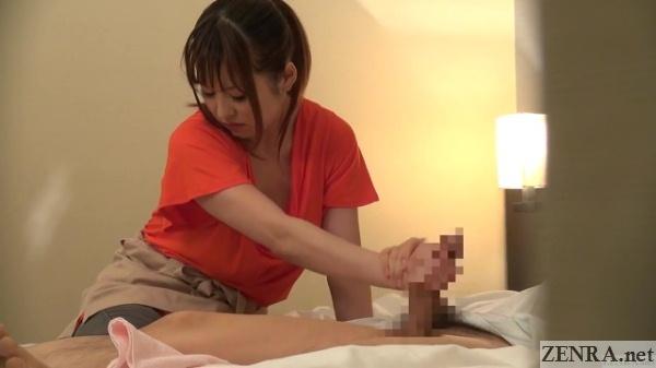 Asian masseuse gives handjob, juicy cameltoe nude
