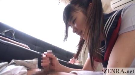 facesitting japanese schoolgirl gives handjob