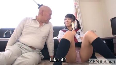 japanese schoolgirl eats ice cream with plunger man