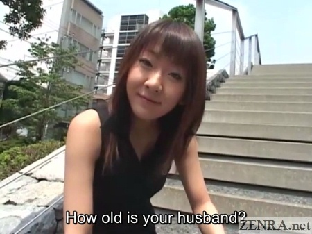 japanese young wife interviewed outside