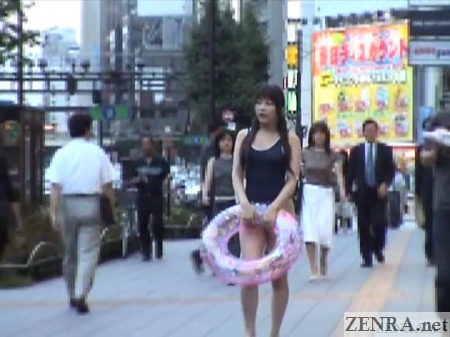 japanese schoolgirl swimsuit in middle of tokyo