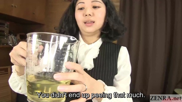 light yellow urine in pitcher held by office lady