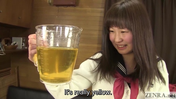 japanese teen with pitcher filled with urine