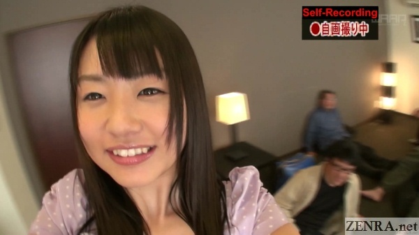 tsubomi holds camera while visiting fans