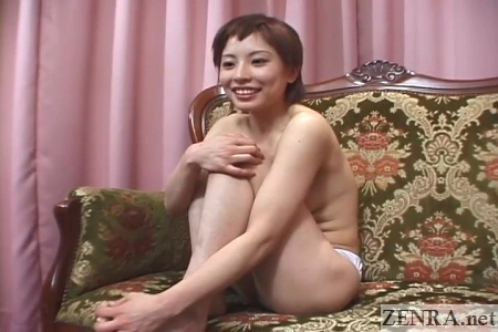 embarrassed japanese woman only in panties legs up against chest
