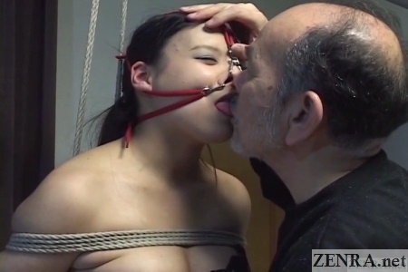 bound japanese woman deep kissing