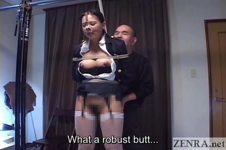half stripped bound japanese woman in garter belt